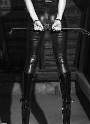 sexy-woman-body-latex-catsuit-dominatrix-holding-whip_cg9p2162441c_th